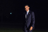 United States President Barack Obama exits Marine One on the South Lawn and walks toward the residence of the White House, in Washington, Tuesday, June 17, 2014. The President is returning from visits to Pittsburgh, Pennsylvania and New York City.<br /> Credit: Drew Angerer / Pool via CNP