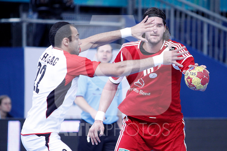 Hungary's Laszlo Nagy (r) and Egypt's Omar Gamal during 23rd Men's Handball World Championship preliminary round match.January 12 ,2013. (ALTERPHOTOS/Acero)