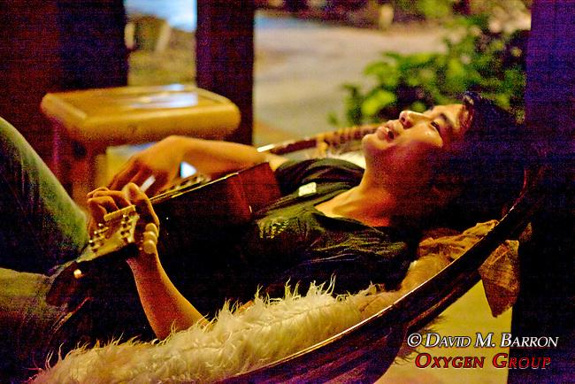 Young Man Playing Guitar At Restaraunt