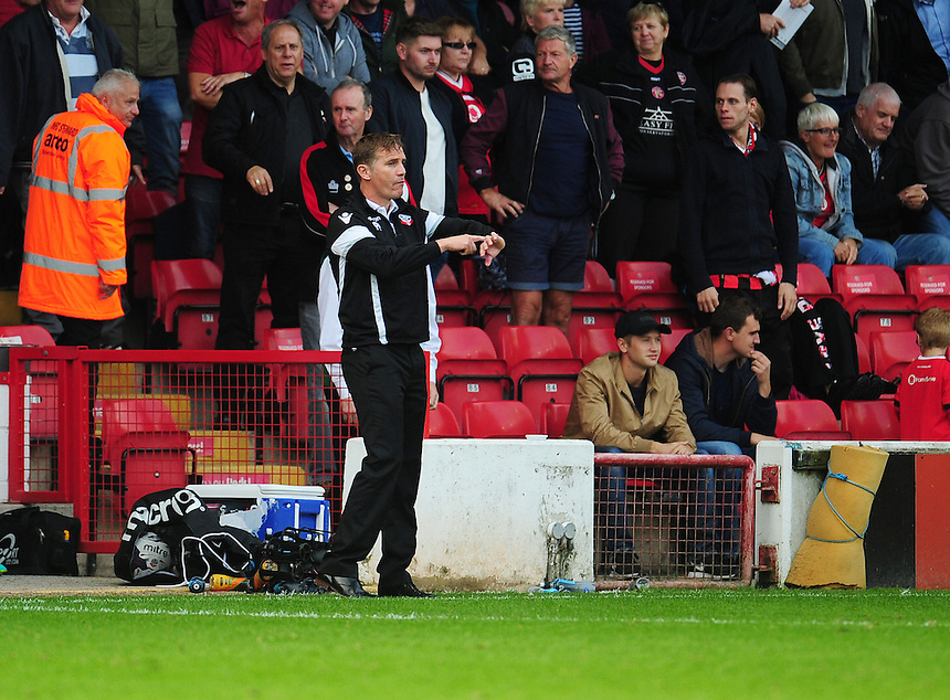 Bolton Wanderers manager Phil Parkinson makes a note of the time being added on for stoppages<br /> <br /> Photographer Kevin Barnes/CameraSport<br /> <br /> The EFL Sky Bet League One - Walsall v Bolton Wanderers - Saturday 17th September 2016 - Banks's Stadium - Walsall<br /> <br /> World Copyright &copy; 2016 CameraSport. All rights reserved. 43 Linden Ave. Countesthorpe. Leicester. England. LE8 5PG - Tel: +44 (0) 116 277 4147 - admin@camerasport.com - www.camerasport.com
