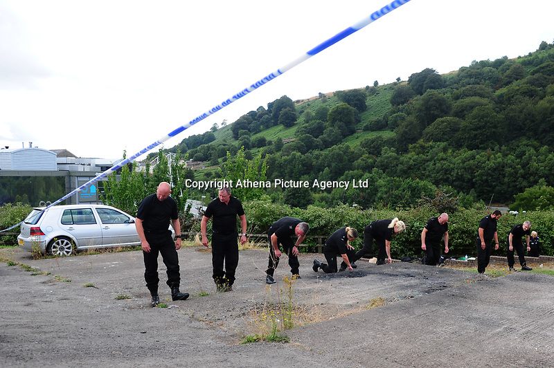 Pictured: Police officers conduct a search at the house where the body of David Gaut was discovered in New Tredegar, Wales, UK. Wednesday 08 August 2018<br /> Re: Three men have been arrested after a man was found dead at a house in New Tredegar, Wales, UK.<br /> David Gaut, 54, was found in Long Row, in the Elliots Town area of New Tredegar, on Saturday, August 4.<br /> Two two-storey terraced homes, owned by Caerphilly council, have been cordoned off and police officers are patrolling the area. <br /> David Gaut was jailed for life in July 1985 when he was 21 years old, for the murder and torture of17-month old Chi Ming Shek