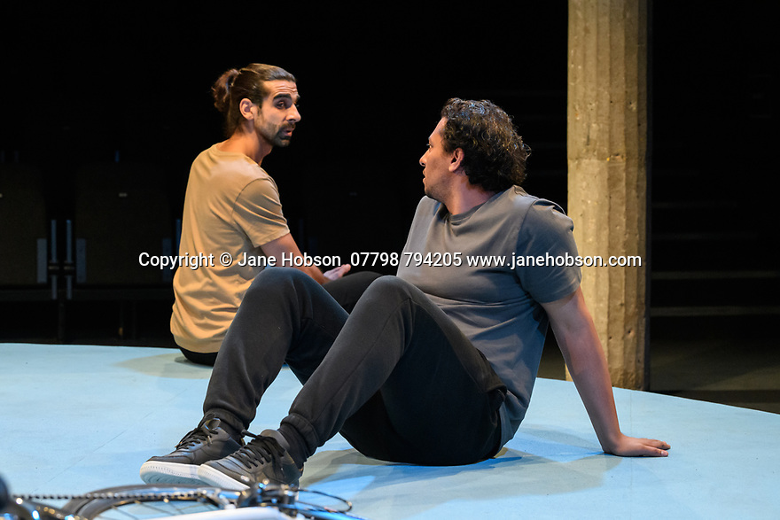 """London, UK. 25.11.2019. """"The Arrival"""", written and directed by Bijan Sheibani, opems at the Bush Theatre. Set and costume design is by Samal Black, lighting design by Oliver Fenwick, movement direction by Aline David. The Picture shows: Scott Karim (Tom), Irfan Shamji (Samad). Photograph © Jane Hobson."""