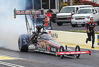 May 10, 2013; Commerce, GA, USA: NHRA crew member for top fuel dragster driver Steve Torrence during qualifying for the Southern Nationals at Atlanta Dragway. Mandatory Credit: Mark J. Rebilas-
