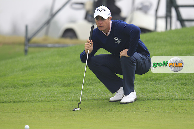 Nicolas Colsaerts (BEL) on the 1st green during Saturay's Round 3 of the 2014 BMW Masters held at Lake Malaren, Shanghai, China. 1st November 2014.<br /> Picture: Eoin Clarke www.golffile.ie