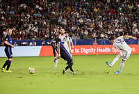 CARSON, CA - SEPTEMBER 21: Uriel Antuna #18 of the Los Angeles Galaxy takes a shot on goal during a game between Montreal Impact and Los Angeles Galaxy at Dignity Health Sports Park on September 21, 2019 in Carson, California.