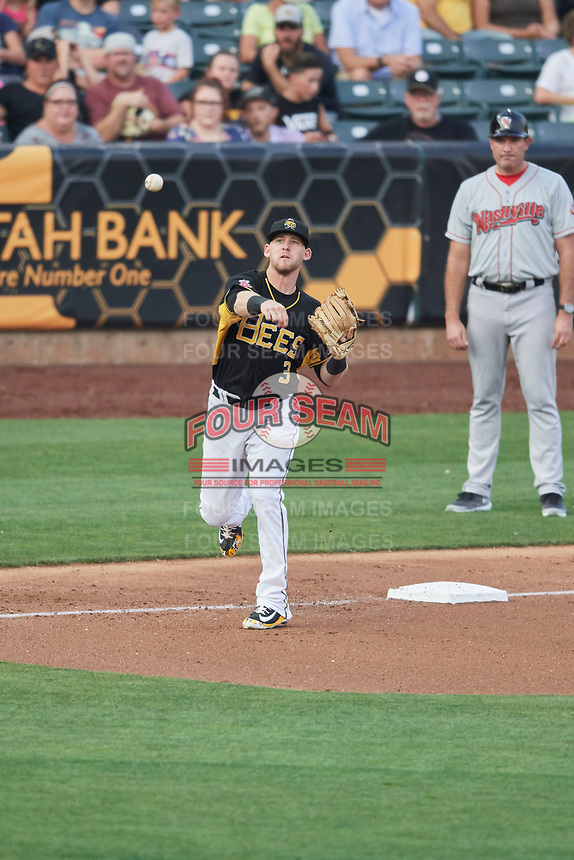 Taylor Ward (3) of the Salt Lake Bees throws to first base against the Nashville Sounds at Smith's Ballpark on July 28, 2018 in Salt Lake City, Utah. The Bees defeated the Sounds 11-6. (Stephen Smith/Four Seam Images)