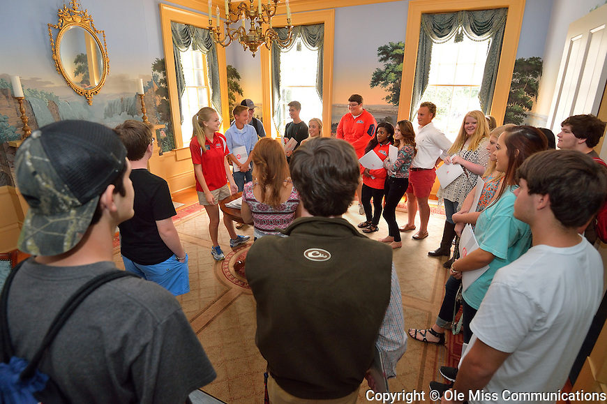 Perspective students and their parents enjoy a tour of one of the Lyceum parlors. Photo by Robert Jordan/Ole Miss Communications