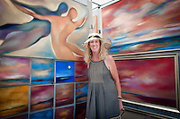 Diane French, St. Augustine Beach, Florida poses in front her dry pigment paintings during the 23rd Annual Downtown Naples Festival of the Arts, hosted by The von Liebig Art Association and Downtown Association, Naples, Florida, USA, March 26, 2011. Photo by Debi Pittman Wilkey