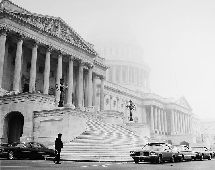 Exterior of Capitol Hill in fog. (Photo by CQ Roll Call via Getty Images)