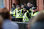 Police and stewards guarding the front door of Ibrox