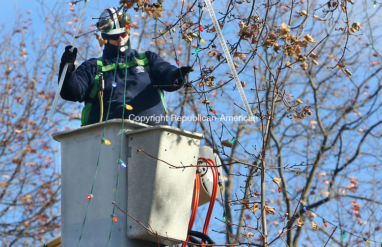 WATERBURY CT. 22 November 2016-112216SV04-Andrew Smedes of the Parks Department hangs Christmas lighting in Library Park in Waterbury Tuesday. The city will have the annual tree lighting at Library Park Sunday, The green is still under construction. <br /> Steven Valenti Republican-American