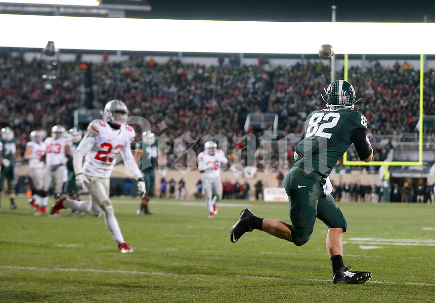 Michigan State Spartans tight end Josiah Price (82) catches a touchdown pass in the fourth quarter of the college football game between the Ohio State Buckeyes and the Michigan State Spartans at Spartan Stadium in East Lansing, Saturday night, November 8, 2014. (The Columbus Dispatch / Eamon Queeney)