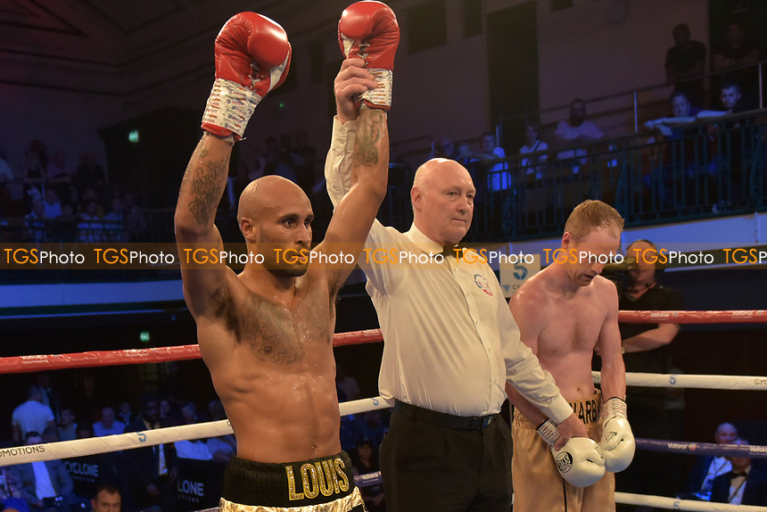 Louis Adolphe (black shorts) defeats William Warburton during a Boxing Show at York Hall on 13th October 2018