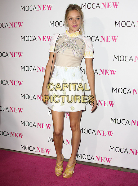 CHLOE SEVIGNY .At MOCA's 30th Anniversary Gala held at MOCA, Los Angeles, California, USA, 14th November 2009. .full length white top skirt beige top pattern silver embellished jewel encrusted yellow high collar bag purse waisted brown tan shoes sandals open toe platform heels polo neck smocked smocking .CAP/ADM/KB.©Kevan Brooks/AdMedia/Capital Pictures.