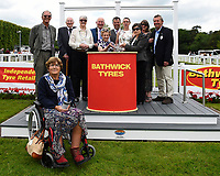 Connections of Simply Breathless receive their trophy for winning The Bathwick Tyres Novice Auction Stakes(plus 10, Div 2),d during Afternoon Racing at Salisbury Racecourse on 13th June 2017