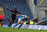 18th July 2020; Ewood Park, Blackburn, Lancashire, England; English Football League Championship Football, Blackburn Rovers versus Reading; Lewis Travis of Blackburn Rovers is fouled by Yakou Meite of Reading