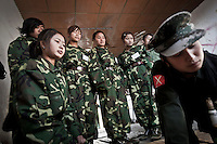 Seng Ra, KIA cobra female soldier teachs to the new female recruits the daily duties at the barrack they have to fulfill every morning at the KIA base camp outskirsts of Maiya Jang city, the second largest city under control of the Kachin Independence rebel Army. Since the begining of the Kachin uprising for its sovereignty women always fought by side the rebel soldiers, but officially, the female KIA was founded in 2007, since then, up to 1500 women have joint to the rebel army. The KIA is enhancing its troops number since the ceasefire was broken out by the Burmese army last June 2011.