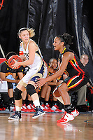 25 November 2011:  FIU guard Zsofia Labady (3) is defended by Maryland guard-forward Alyssa Thomas (25) in the first half as the University of Maryland Terrapins defeated the FIU Golden Panthers, 84-52, at the U.S. Century Bank Arena in Miami, Florida.
