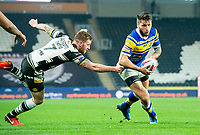 Picture by Allan McKenzie/SWpix.com - 19/04/2018 - Rugby League - Betfred Super League - Hull FC v Leeds Rhinos - KC Stadium, Kingston upon Hull, England - Tom briscoe evades Marc Sneyd's tackle.