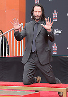 MAY 14 Keanu Reeves Places His Hand Prints In Cement