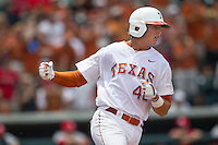 Texas Longhorns first baseman Kacy Clemens (42) celebrates after driving in a run during the 4th inning of the NCAA Super Regional baseball game against the Houston Cougars on June 7, 2014 at UFCU Disch–Falk Field in Austin, Texas. The Longhorns are headed to the College World Series after they defeated the Cougars 4-0 in Game 2 of the NCAA Super Regional. (Andrew Woolley/Four Seam Images)