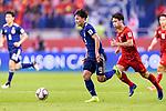 Minamino Takumi of Japan (C) in action during the AFC Asian Cup UAE 2019 Quarter Finals match between Vietnam (VIE) and Japan (JPN) at Al Maktoum Stadium on 24 January 2018 in Dubai, United Arab Emirates. Photo by Marcio Rodrigo Machado / Power Sport Images