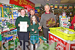 Aghatubrid National School cashing in on their organic garden produce at Walsh's Super Valu, Cahersiveen last week, pictured here front l-r, Mikayla Corcoran, Tessa Sugrue, back l-r; Billy Enright(Caretaker) & John Joe Kelly their first customer of the day.