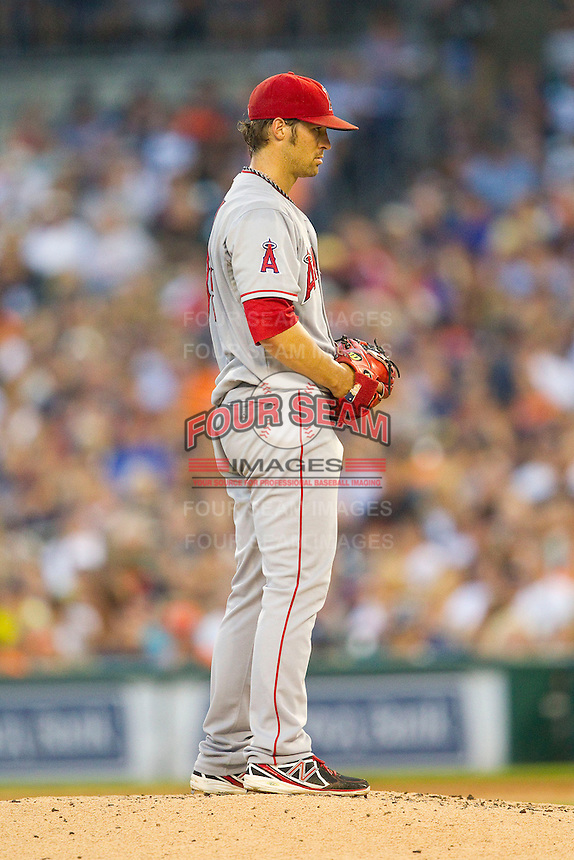 Los Angeles Angels starting pitcher C.J. Wilson (33) looks to his catcher for the sign against the Detroit Tigers at Comerica Park on June 25, 2013 in Detroit, Michigan.  The Angels defeated the Tigers 14-8.  (Brian Westerholt/Four Seam Images)
