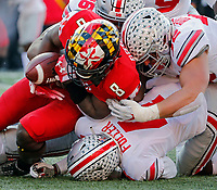 Ohio State Buckeyes safety Jordan Fuller (4) and Ohio State Buckeyes linebacker Tuf Borland (32) tackle Maryland Terrapins running back Tayon Fleet-Davis (8) during the 3rd quarter of their game at Capital One Field at Maryland Stadium in College Park, Maryland on November 17, 2018. [Kyle Robertson/Dispatch]
