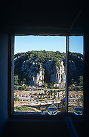 A view from a window to the dramatic limestone cliffs that hang over the Ardeche river