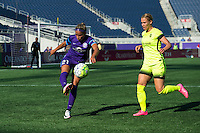 Orlando, Florida - Sunday, May 8, 2016: Orlando Pride defender Monica Hickman Alves (21) clears the ball while pressured by Seattle Reign FC forward Merritt Mathias (9) during a National Women's Soccer League match between Orlando Pride and Seattle Reign FC at Camping World Stadium.