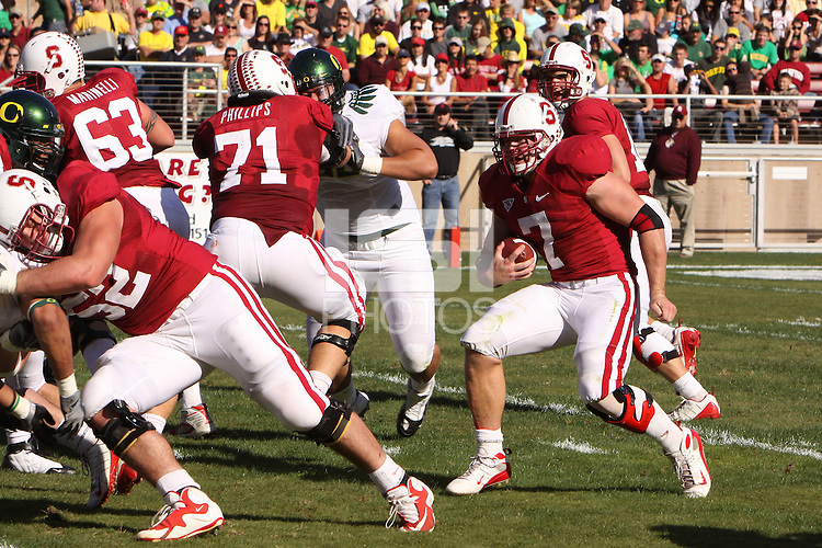 STANFORD, CA - NOVEMBER 7:  Toby Gerhart of the Stanford Cardinal follows David DeCastro during Stanford's 51-42 win over the #7 ranked Oregon Ducks on November 7, 2009 at Stanford Stadium in Stanford, California. Also blocking is Chris Marinelli and Andrew Phillips.