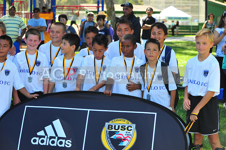 BUSC Technical Director Kevin Crow and delivers trophies and medals to the  2010 BUSC Summer Classic participants in Pleasanton California August 14, 2010. (Photo by Alan Greth)