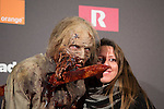 Actors dressed up like zombies pose with fans during The Walking Dead: 6th Season presentation in Madrid, Spain. February 23, 2016. (ALTERPHOTOS/Victor Blanco)