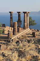 Temple of Athena, Doric temple built 530 BC on the acropolis of Assos, Turkey, with a view over the Aegean Sea. This is the only Archaic temple in the Doric style known so far in Asia Minor. It was in use during the Hellenistic Age and was 30x14m in size, although only 6 of the orignal 38 columns remain. The temple is made from local andesite. Assos was founded from 1000 to 900 BC by Aeolian colonists from Lesbos. Aristotle (joined by Xenocrates) went to Assos, where he was welcomed by King Hermias, and opened an Academy in this city, where he led an influential group of philosophers. Picture by Manuel Cohen