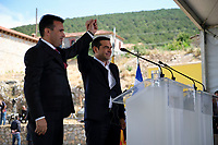 Pictured: Greek Prime Minister Alexis Tsipras (R) with his counterpart Zoran Zaevat (L) at Prespa Lake in northern Greece. Sunday 17 June 2018<br /> Re: Greece and the Former Yugoslav Republic Of Macedonia (FYROM) have signed a deal that aims to settle a decades-long dispute over the country's name.<br /> Under the agreement, Greece's neighbour will be known as North Macedonia.<br /> Heated rows over Macedonia's name have been going on since the break-up of the former Yugoslavia, of which it was a part, and have held up Macedonia's entry to Nato and the EU.<br /> Greece has long argued that by using the name Macedonia, its neighbour was implying it had a claim on the northern Greek province also called Macedonia.<br /> The two countries' leaders, Mr Tsipras and his Macedonian counterpart Zoran Zaev announced the deal on Tuesday and have pressed ahead despite protests.<br /> The two countries' foreign ministers signed the deal on Lake Prespa on Greece's northern border on Sunday.<br /> The agreement still needs to be approved by both parliaments and by a referendum in Macedonia.