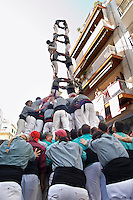 Human tower competition, castellers,  Climbing up. Sitges, Catalonia, Spain