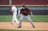 Austin Beck (23) of the North Davidson Knights takes his lead off of second base against the Alexander Central Cougars at Bob Gryder Stadium on March 25, 2017 in Taylorsville, North Carolina.  The Knights defeated the Cougars 3-0.  (Brian Westerholt/Four Seam Images)