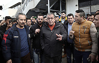 Pictured: Migration Minister Yiannis Mouzalas in the camp Monday 06 February 2017<br /> Re: Scuffles between migrants and police broke out during a visit by Immigration Policy Minister Yiannis Mouzalas at the Elliniko migrant camp located in the former airport in the outskirts of Athens, Greece.
