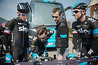 'maestro' Bernie Eisel (AUT/SKY) showing teammates Geraint Thomas (GBR/SKY) &amp; Ian Stannard (GBR/SKY) and DS Kurt-Asle Arvesen (NOR) how to get the bike computer ready for action<br /> <br /> 57th E3 Harelbeke 2014