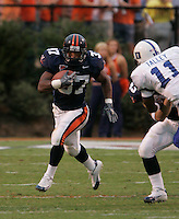 UVa football runningback Cedric Peerman for the Virginia Cavaliers playing in Scott Stadium at the University of Virginia in Charlottesville, VA. Photo/Andrew Shurtleff.