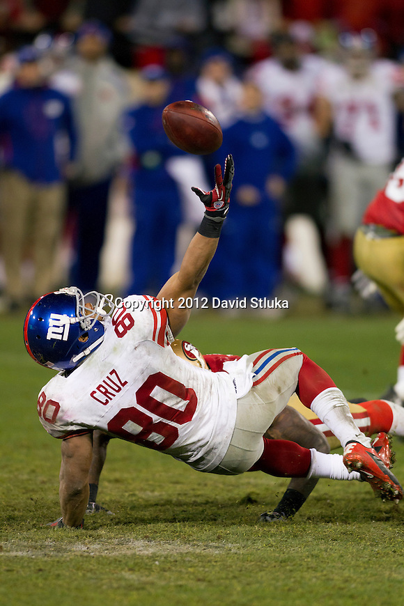 New York Giants wide receiver Victor Cruz (80) bobbles the ball during an NFC Championship NFL football game against the San Francisco 49ers on January 22, 2012 in San Francisco, California. The Giants won 20-17 in overtime. (AP Photo/David Stluka)