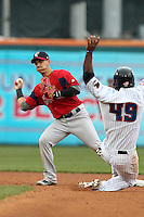Pawtucket Red Sox shortstop Jose Iglesias #10 attempts to turn a double play as Raul Reyes #49 slides in during a game against the Buffalo Bisons at Coca-Cola Field on April 15, 2012 in Buffalo, New York.  Buffalo defeated Pawtucket 10-9 in ten innings.  (Mike Janes/Four Seam Images)