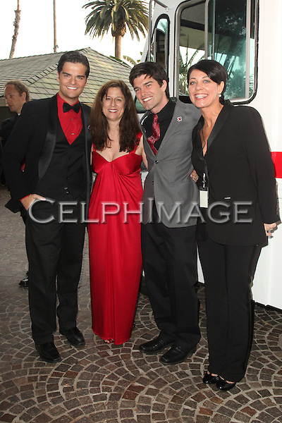 "BEN DECKER, MARCIA CALDIROLA, JORDAN JOHNSON, CHRISTINE PEAKE. Red carpet arrivals to the annual ""Red Tie Affair,"" benefitting the American Red Cross of Santa Monica, and honoring the humanitarian spirit of those who have shown courage, unselfish character and whose work has saved lives. At the Fairmont Miramar. Santa Monica, CA, USA. April 17, 2010."