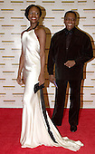 "Ebony Haswell and Arthur Mitchell arrive at the Harry S. Truman Building (Department of State) in Washington, D.C. on December 4, 2004 for a dinner hosted by United States Secretary of State Colin Powell.  At the dinner six performing arts legends will receive the Kennedy Center Honors of 2004.  This is the 27th year that the honors have been bestowed on ""extraordinary individuals whose unique and abundant artistry has contributed significantly to the cultural life of our nation and the world"" said John F. Kennedy Center for the Performing Arts Chairman Stephen A. Schwarzman.  The award recipients are: actor, director, producer, and writer Warren Beatty; husband-and-wife actors, writers and producers Ossie Davis and Ruby Dee; singer and composer Elton John; soprano Joan Sutherland; and composer and conductor John Williams.<br /> Credit: Ron Sachs / CNP"