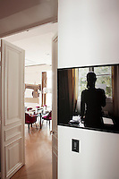 "A photograph by Sophie Calle ""Prenez Soins de Vous"" hangs just outside the door to the dining room"