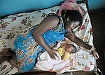In a clinic of the United Methodist Church in Kananga, a town in the Democratic Republic of the Congo, Jephanie Kabulu-Longo rests with her newborn boy, Kiungu, just hours after giving birth.
