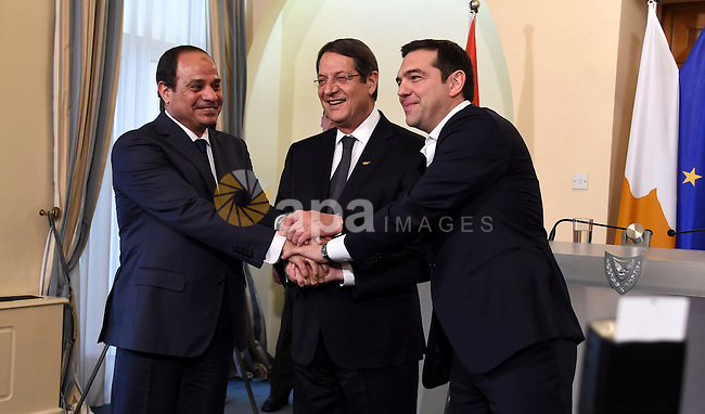 President of the Republic of Cyprus, Nikos Anastasiades (C), Egyptian President Abdel Fattah al-Sisi (L) and Greek Prime Minister Alexis Tsipras (R) shake hands after the press conference in Nicosia, Cyprus, 29 April 2015. Cyprus, Greece and Egypt are holding a follow-up Cyprus-Greece-Egypt tripartite economic relations meeting on shipping, tourism and energy in Nicosia aimed at establishing greater cooperation in the eastern Mediterranean. Photo by Egyptian Presidency. Photo by Egyptian Presidency