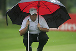 Shane Lowry (IRL) shelters from the rain as he lines up his putt on the 3rd green during Day 1 of the BMW International Open at Golf Club Munchen Eichenried, Germany, 23rd June 2011 (Photo Eoin Clarke/www.golffile.ie)