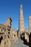 General view of Islam Hodja Minaret, 1910, Khiva, Uzbekistan, pictured on July 5, 2010, in the afternoon. Commissioned by the reforming Grand Visier, Islam Khodja, the minaret is 44.8 metres high, tapering towards the top, its ochre brick alternating with bands of decorative blue and white tiles. It is the final architectural achievement of the Khanates. Khiva, ancient and remote, is the most intact Silk Road city. Ichan Kala, its old town, was the first site in Uzbekistan to become a World Heritage Site(1991). Picture by Manuel Cohen.